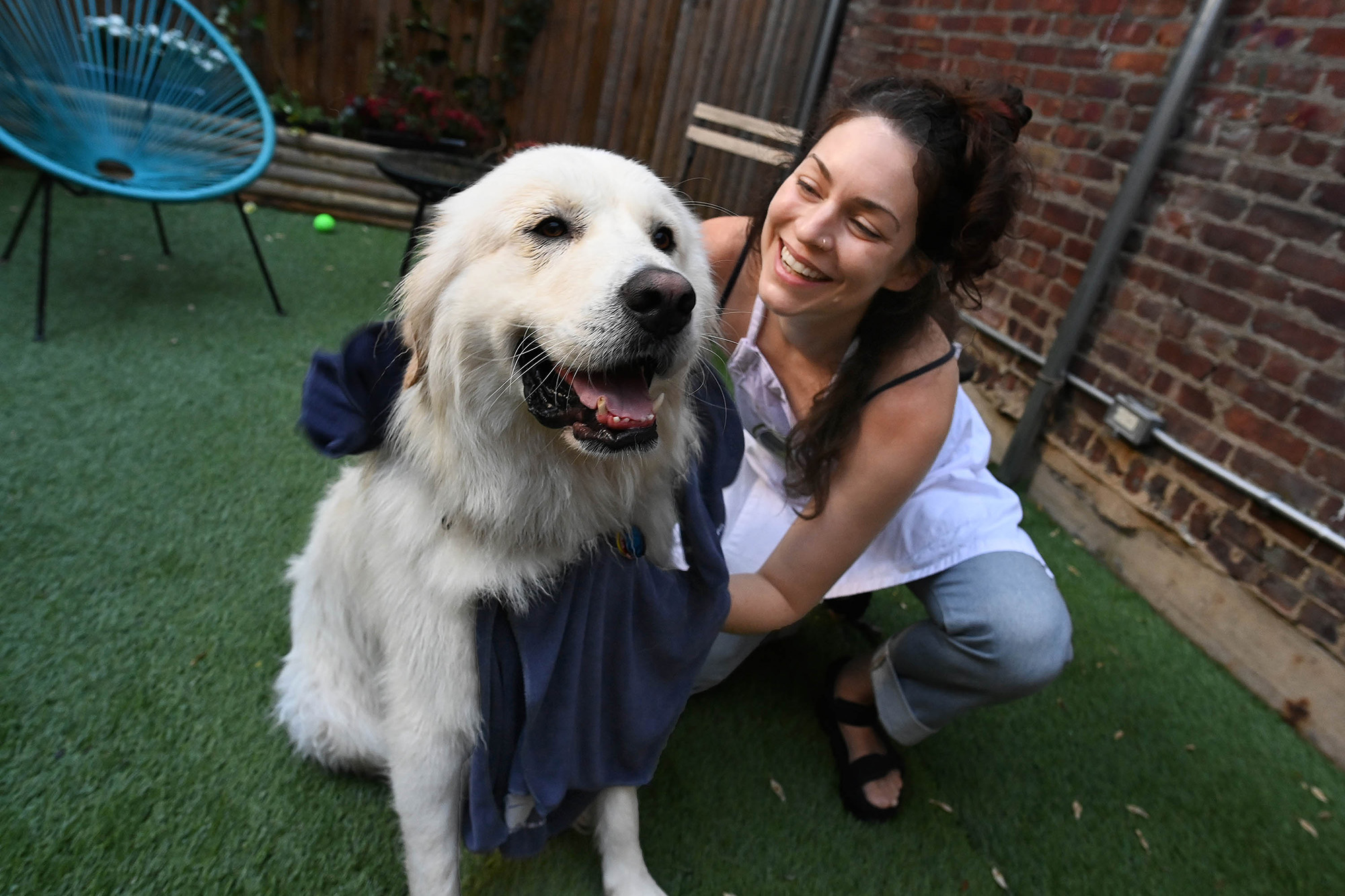 Kris Chan, Butters' owner, comes from Fort Greene to wash Butters at this first self-service dog wash spa and boutique.