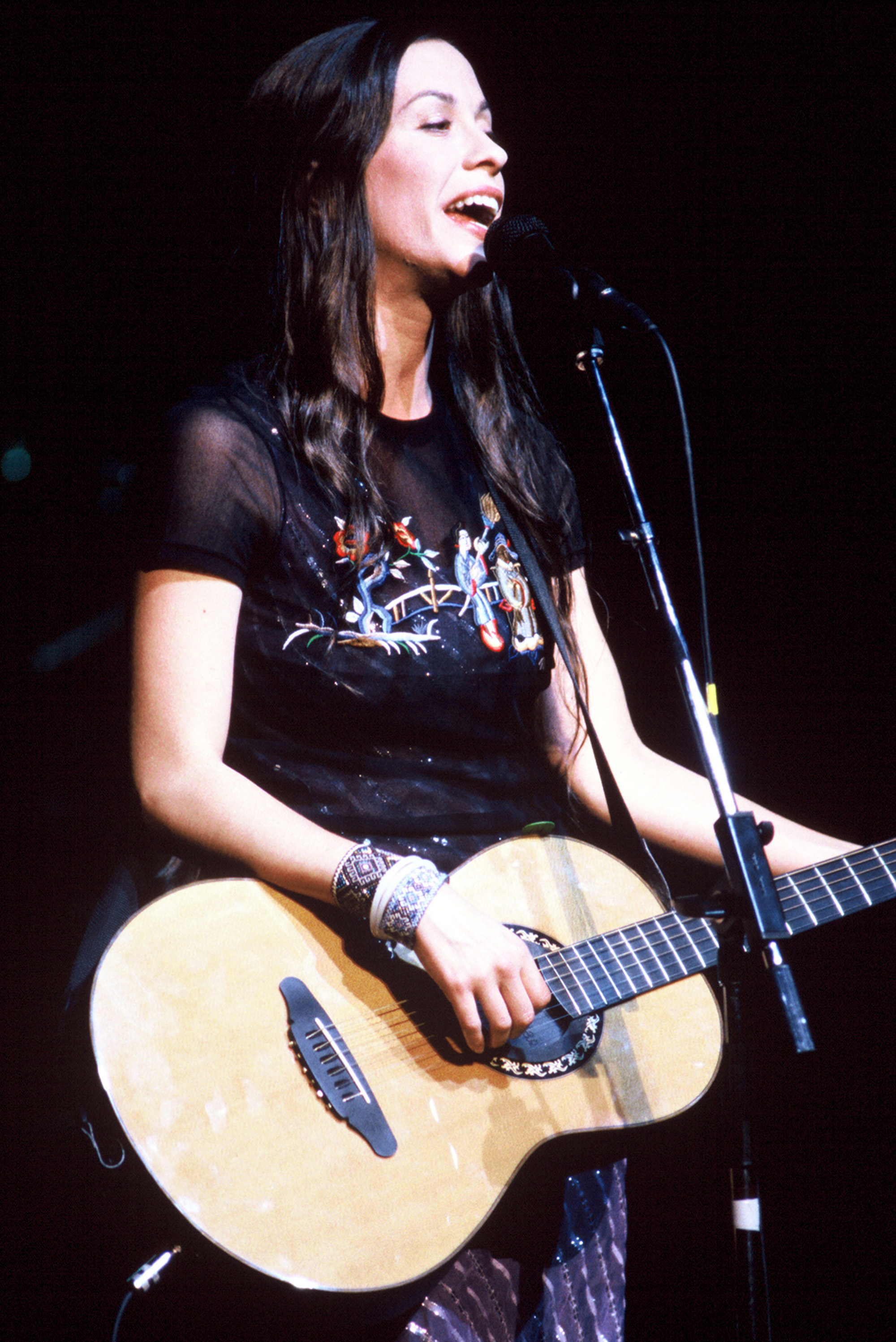Alanis Morissette says that when she turned 15, men in the music industry began to aggressively hit on her.