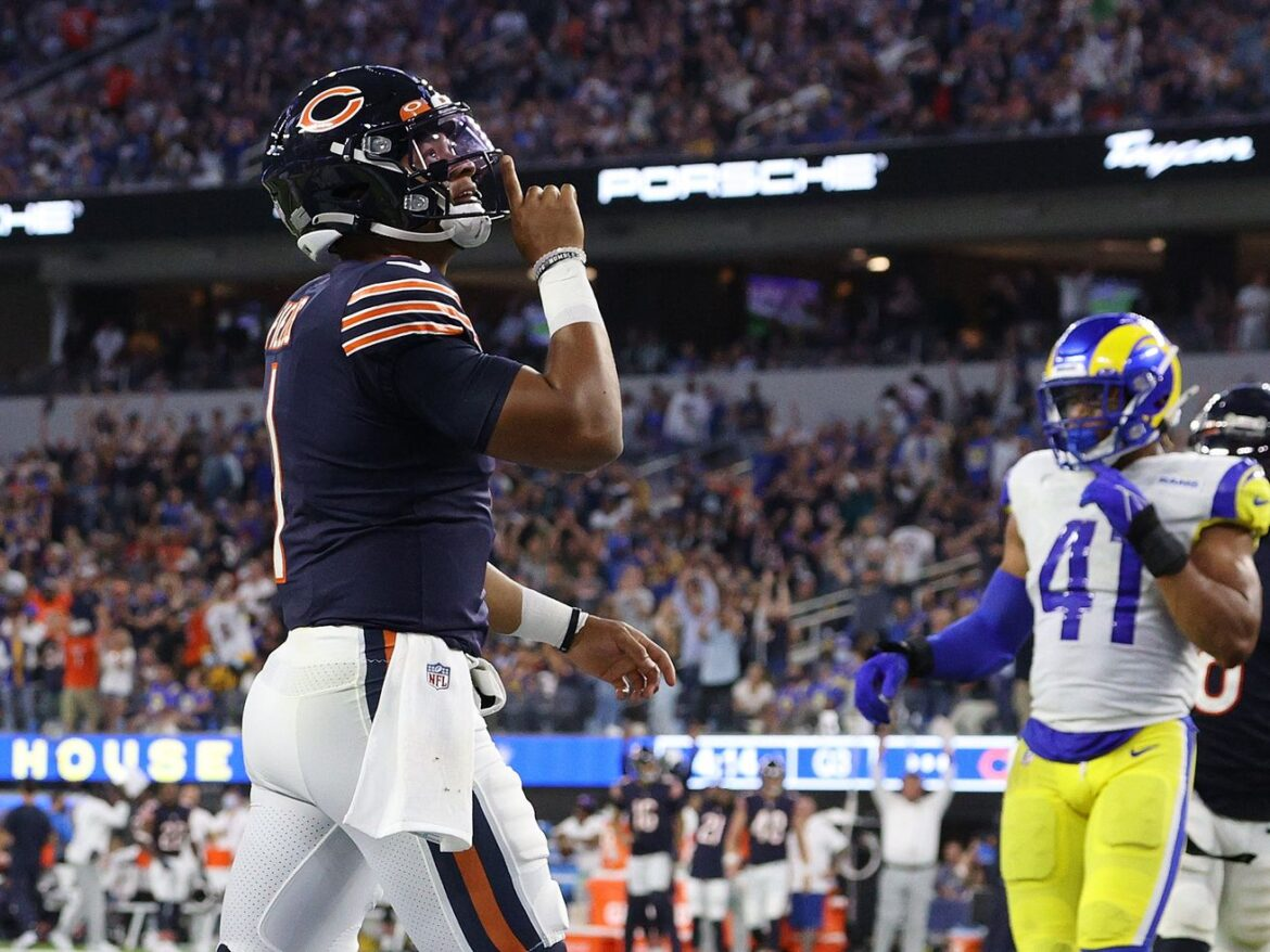 Bears put Justin Fields to work in opener