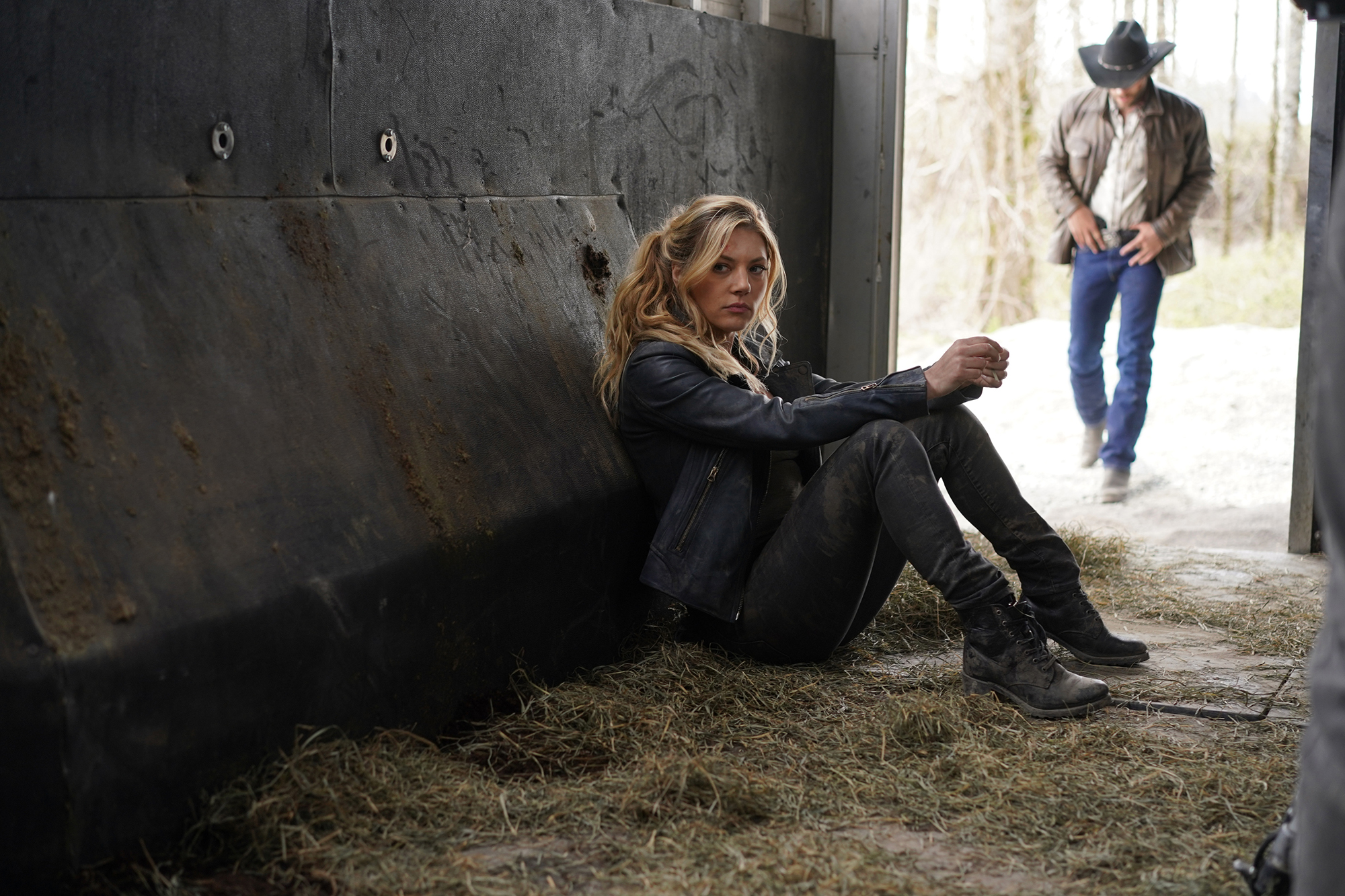 """Katheryn Winnick as Jenny Hoyt sits on the ground leaning against a stone wall in the dark in """"Big Sky."""""""