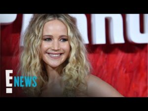 Pregnant Jennifer Lawrence Cradles Baby Bump During NYC Outing | E! News