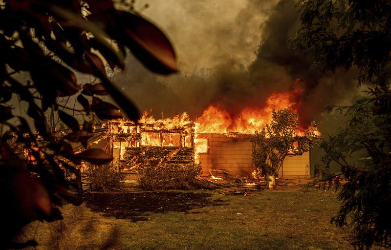 Teams check destruction from Northern California forest fire