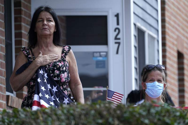The Latest: Marine killed by Afghan bomb comes home to US