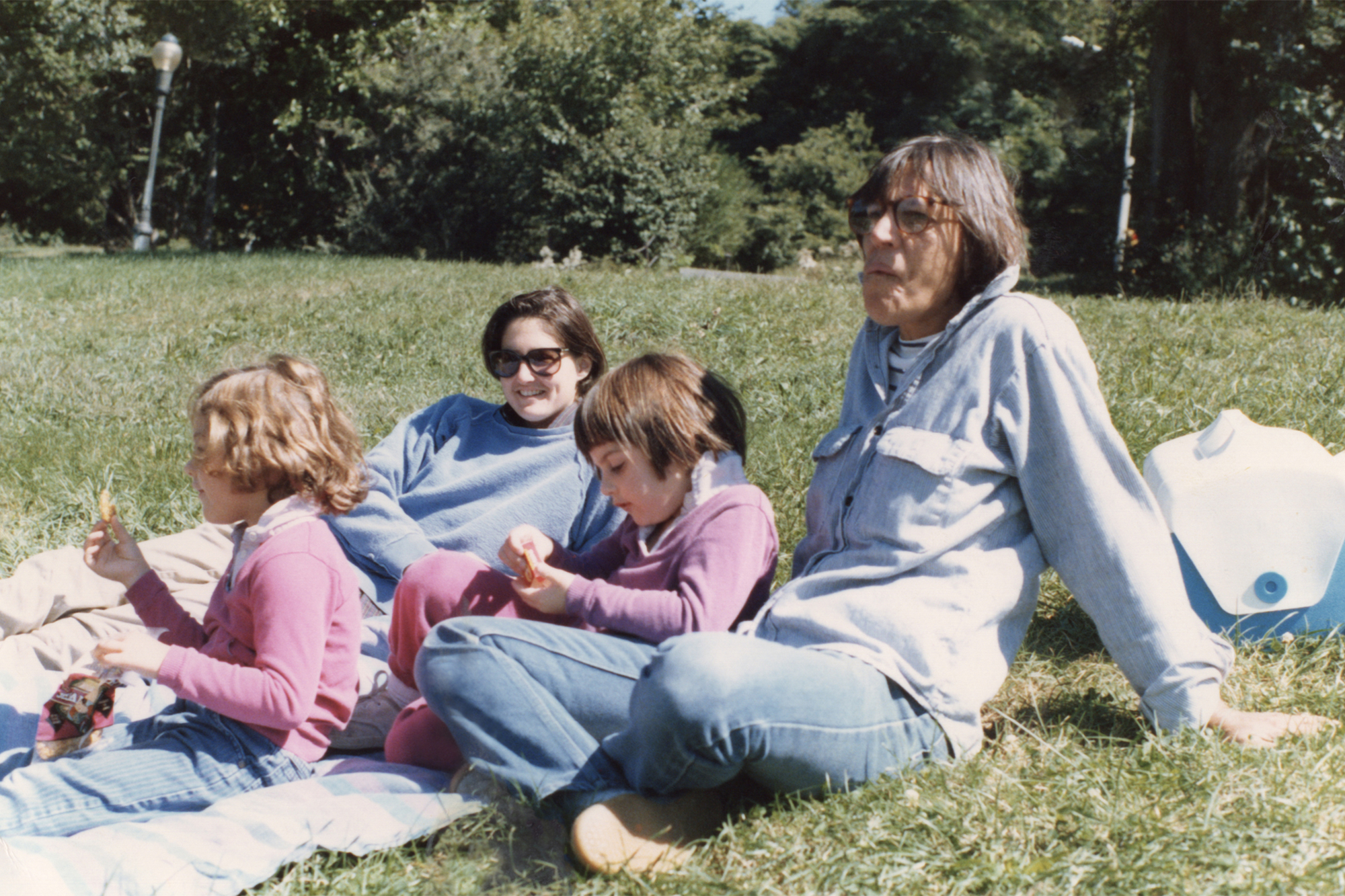 """""""My childhood was very magical,"""" prior to the trial, said Ry, here with her sister Cade with their moms, Robin Young and Sandy Russo."""