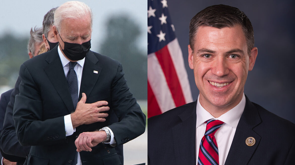 Rep. Banks jabs Biden with hallway poster of president checking watch