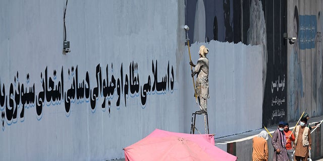 Taliban painting over western murals in Kabul, including George Floyd mural