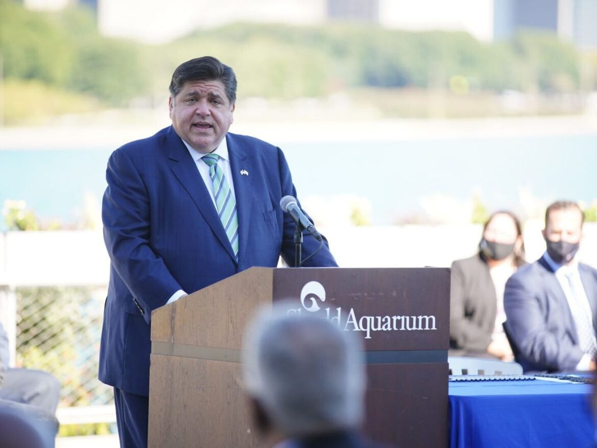 'There is no time to lose,' Pritzker says as he signs sweeping energy legislation