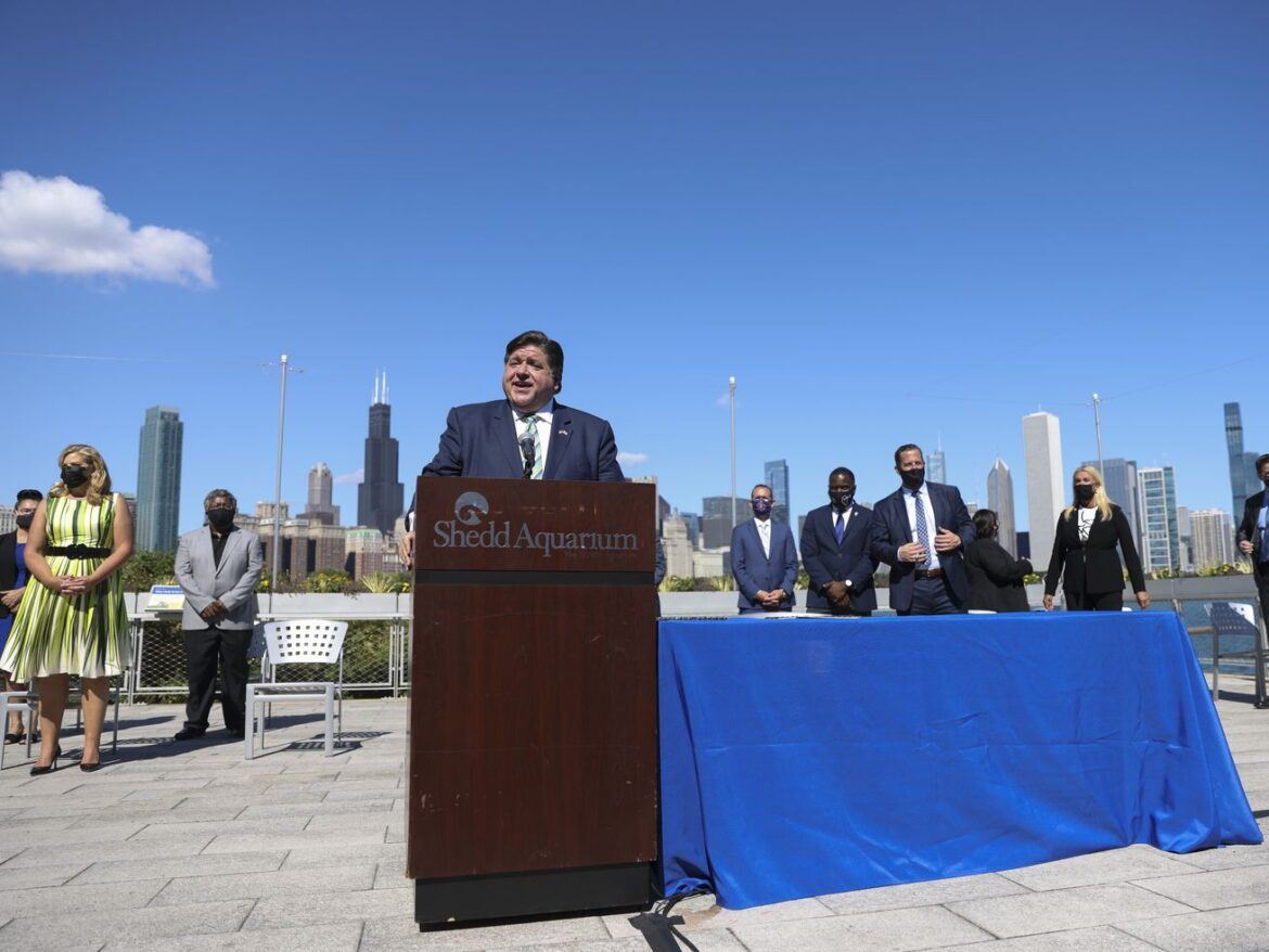'There is no time to lose,' Pritzker says as he signs sweeping energy legislation he says makes Illinois 'a force for good'