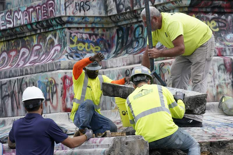 Crews pause search for 1887 Confederate statue time capsule