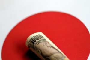 Yen subdued, Aussie firm on improved sentiment before central bank meetings