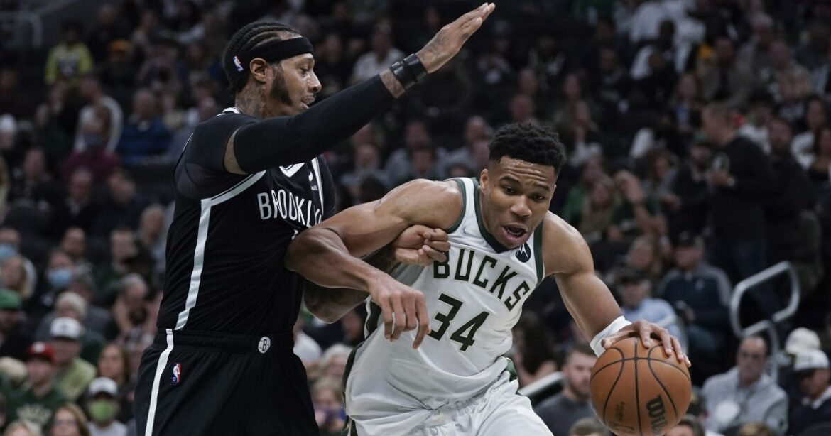 NBA: Bucks begin title defense with victory over Nets